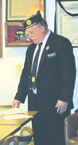OBSERVER Photo by Rebecca Cuthbert American Legion Post 62 Commander Jim Lemanski spoke somberly Wednesday about those who served their country and sacrificed their lives during Japan's attack on Pearl Harbor in 1941.
