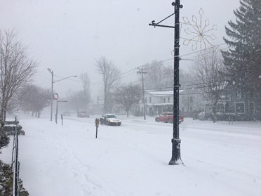 Snow falls on Fredonia this afternoon along Main Street.