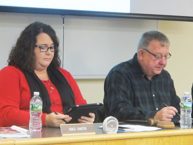 OBSERVER Photo by Amanda Dedie Board of Education member Julie Smith and Board President David Damico read off the winning bids for the Dunkirk Central School District's P-TECH project.
