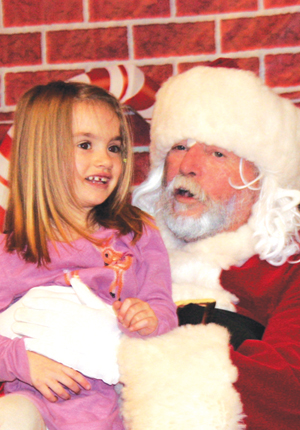 Santa Claus traverses Christmas past, present and future, bringing joy to children. Here he asks Emerson Dodd, 4, if she was a good girl this year. Emerson is the daughter of Tonja and Damian of Westfield; granddaughter of Donna and Dave Nichols of Gerry and Lynn and Larry Dutton of Hagerstown, Md.