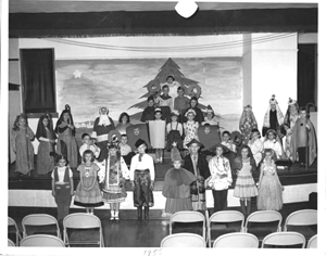 Diane Chodan, front and center, played the role of the Christmas tree in first grade.