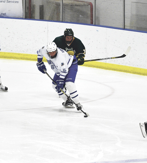 OBSERVER Photo by Roger Coda Fredonia's Jacob Haynes (6) keeps the puck away from an Oswego player during Friday's SUNYAC men's college hockey game at Steele Hall.