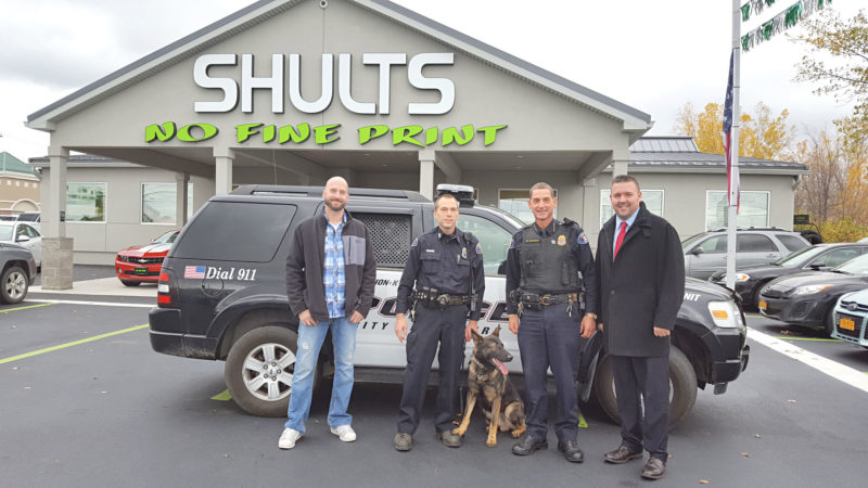OBSERVER Photos above and below by Nicole Gugino Donations made a custom K-9 vehicle possible for the Dunkirk Police Department. Pictured from left is Nathan Green of Custom Collision, K-9 Officer Matt Hazelton with K-9 Nico, Chief David Ortolano and Mike Dougherty of Shults Resale.