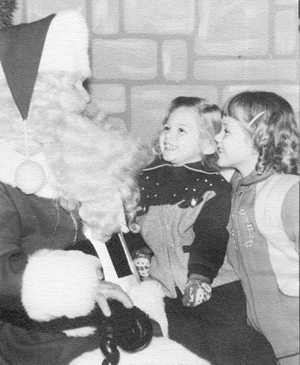 Dawn  Bliss (eventually Ingham), left, and sister Vicki Bliss (eventually Notaro), right,  are enchanted by Santa in the mid '50s.