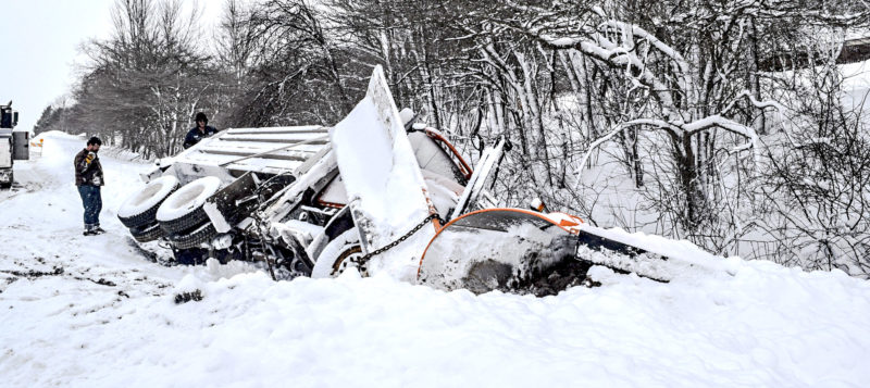 OBSERVERPhoto by Dan Kohler A snowplow skidded off the roadway and tumbled into a ditch along Bowers Road in Stockton Thursday morning. No injuries were reported.