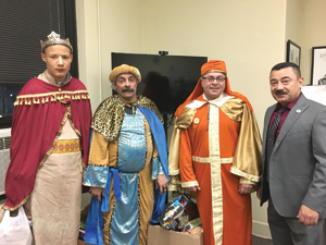 OBSERVER Photo by Andrew Kuczkowski The city of Dunkirk celebrated Three King's Day with a cavalcade of gifts along with donated food and beverages. Above are the three kings with Mayor Willie Rosas on the right.