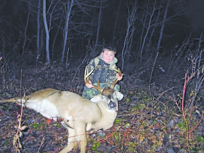 Submitted Photo Six-year-old Vince Prinzbach, a first grader at Silver Creek Central School, helps display a nice 9-point buck taken by his father Michael Prinzbach on Dec. 4 while hunting in Stockton.