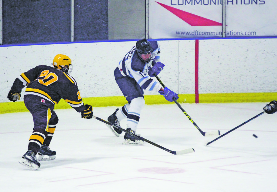 OBSERVERPhoto by Mary Ann Wiberg Dunkirk-Fredonia's Mike Meredith takes a shot on net during his team's Western New York High School Club Hockey League game against City Honors-Cardinal O'Hara, on Sunday, at the Steele Hall Ice Arena. The Steelers won, 4-3.
