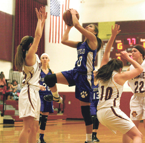 Photo by Cody Crandall Westfield's Kiara Booker (30) drives to the basket while Clymer defenders look on during Monday's CCAA West 2 girls high school basketball game.