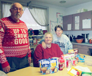 Submitted Photo Staff and participants at The Resource Center's Day Program on Lake Shore Drive in Dunkirk recently held a food drive, collecting 40 pounds of food that was donated to the Friendly Kitchen in Dunkirk. Posing with some of the collected food are, from left, Gary Scherer, Jennifer DeWolf and Lisa Pogorzelski.