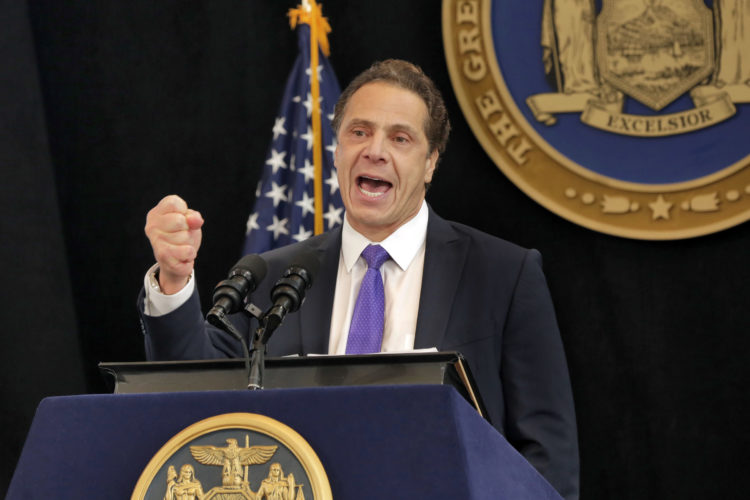 New York Gov. Andrew Cuomo delivers one of his State of the State addresses in New York's One World Trade Center building, Monday, Jan. 9, 2017. New York state must stand as an alternative to the policies and pronouncements of President-elect Donald Trump and show the nation progressive achievements, racial and religious tolerance and that big investments in education and infrastructure can create a dynamic economy that works for all, Cuomo said Monday. (AP Photo/Richard Drew)