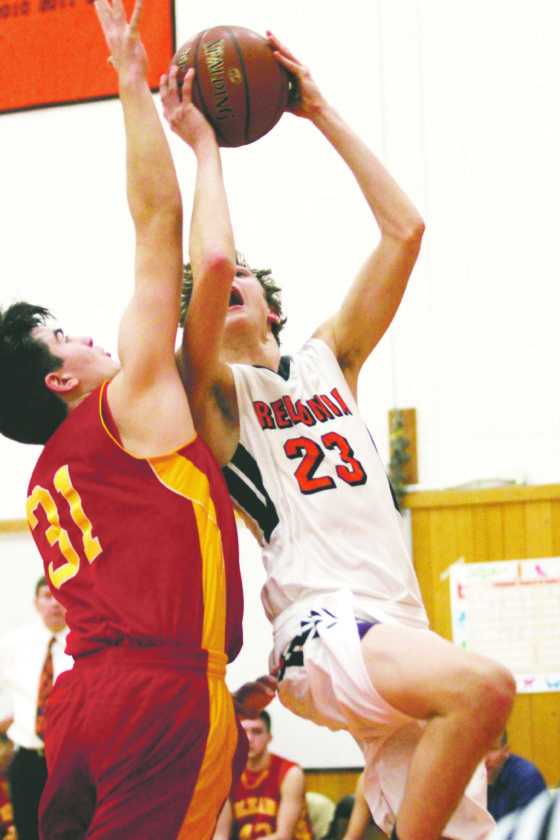 OBSERVERPhoto by Lisa Monacelli Fredonia's Nick Ruckman (23) attempts a shot over Olean's Luke Rogers (31) duringTuesday's CCAAWest 1 boys high school basketball game.