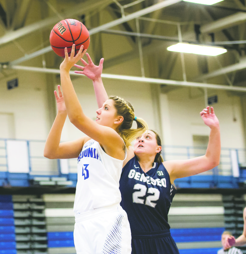 OBSERVERPhoto by Ron Szot  Fredonia's Jamie Curry (43) works inside against Geneseo's Katie Vinneau (22) duringTuesday's SUNYAC women's college basketball game at the Steele Hall Fieldhouse.