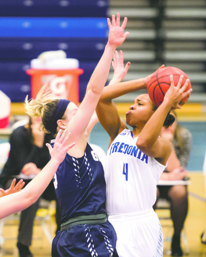 OBSERVERPhoto by RonSzot Fredonia's Khee Nance (4) drives to the basket against Geneseo's Kayleigh Cavanaugh (3) duringTuesday's SUNYACwomen's college basketball game at theSteele Hall Fieldhouse.
