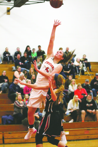 Fredonia's Hannah Cybart (4) puts up a shot during the Lady Hillbillies' contest against theSouthwestern Lady Trojans.