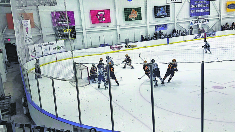 Submitted Photo Dunkirk-Fredonia Steeler players put heat on City Honors/Cardinal O'Hara during the second period of a 6-1 victory.