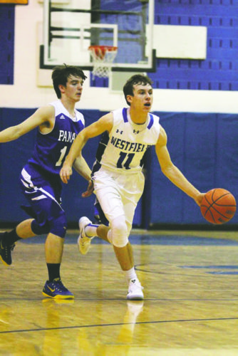 OBSERVERPhoto by Mary AnnWiberg Westfield's David Grayson (11) looks to push the ball up the court duringTuesday's CCAAWest 2 boys high school basketball game against Panama.  Also pictured is Panama's Lucas Golden  (14).