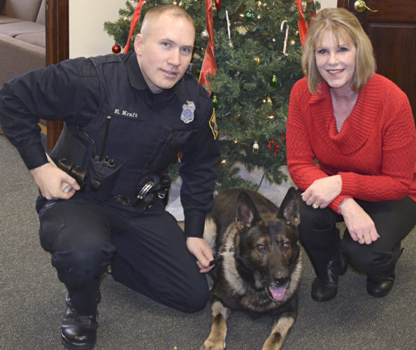 "Submitted Photo Sen. Cathy Young (right) has introduced ""Mitchell's Law,"" which would make it a felony to injure a police dog in the line of duty, in honor of Hero K-9 Officer Mitchell of the Jamestown Police Department. Also pictured is Mitchell's handler, Officer Erik Kraft."