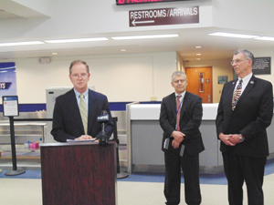 Photo by Jimmy McCarthy Ron Almeter (left) was introduced as the new airport manager Friday by Public Facilities Director George Spanos (center) and County Executive Vince Horrigan.