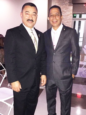 Submitted Photo A personal trip to Puerto Rico turned into more for Dunkirk Mayor Willie Rosas (left) last week. Rosas was invited to the inauguration of city of San German Mayor Isidro Negron Irizarry (right). Rosas was seated onstage and recognized with other dignitaries and recognized as New York state's first hispanic mayor. Rosas was able to speak with local mayors in the city neighboring the township where his mother resides and give out city of Dunkirk pins.