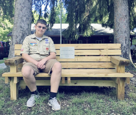 aSubmitted Photo Brandon Powell, a member of Boy Scout Troop 267, recently received the rank of Eagle Scout. Powell built the bench pictured and eight others as part of his Eagle Project. Camp Gross in Cassadaga is home to the benches.
