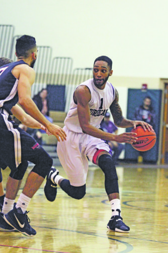 OBSERVERPhoto by Mary AnnWiberg Chautauqua's Tyquan Stroman brings the ball upcourt during Saturday's Premier Basketball League game against the Washington Warhawks, at Brocton Central School.