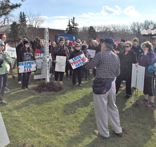 OBSERVER Photo by Jordan W. Patterson. SUNY Fredonia Physics lecturer J. David Swift (right) speaks during a peaceful protest of Donald Trump's presidency in Fredonia on Saturday.