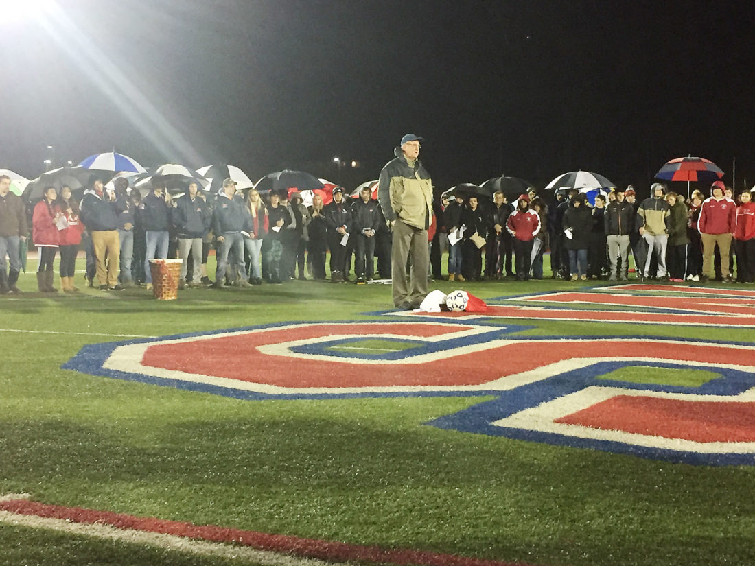 Pictured is Southwestern soccer coach Mike Sleggs at a vigil for Justin Romaniuk, who died as a result of an accident Monday.