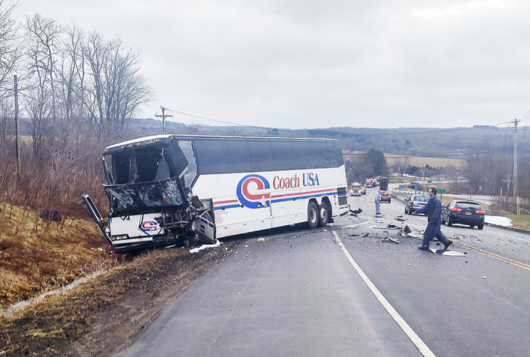 OBSERVER Photo by Dan Kohler Above: Debra Lee Grimes was the driver of this USA Coach Bus that was struck Monday morning.