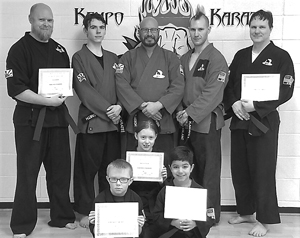 Submitted Photo The Family Martial Arts Center and the Kempo Karate Organization recently honored students who advanced to their next belt level. They are, in front from left, Kohai Alex Bouquin and Kohai Yair Collazo. In the second row is Kohai Shannon Bordenkircher. In back are Kohai Doug Bordenkircher, Sensei Tim Smith, Master Sensei Bill Matteson, Sensei Don LeBlanc and Sempei Matt Benware.