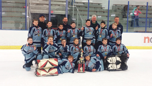 Submitted Photo The NCCYHA Squirt select team won its division championship at the Top Gun Tournament in Amherst recently. The team went undefeated with a 5-0 record for the weekend. Picturd are members of the team. They are, in front from left, Brock Eppinger and Eli Himelein. In the second row are Brady Crawford, Derek Paradis, Canyon Bellis, Joella Bauza, Connor Nowicki, Brayden Bugaj and Colin Pergrim. In the third row are Isaac Williams, Jacob Majka, Nathan Sercu, Josh Pless, Owen Rush, Nolan Olson and Addison Paluch. In back are assistant coach Steve Olson, head coach Brian Crawford, assistant coach Dave Paradis and assistant coach Jim Rush.