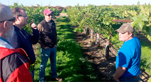 Submitted Photo Thom Betts (right) discusses variable rate irrigation systems in a Gallo Wine Company vineyard in Lodi, California.
