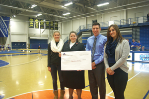 Submitted Photo The Student Athlete Advisory Committee (SAAC) at the State University of New York at Fredonia collected money at games and meets during the holiday season to help local families in need. The students raised $402.39, which was donated to the local Salvation Army. A check was presented to Lieutenant Samantha Lockerd during halftime of the varsity women's basketball game on Monday, Jan. 31. Participating in the check presentation are, from left, Megan Collins, volleyball and co-president of SAAC; Lieutenant Samantha Lockerd, Salvation Army; Ben Chatley, swimming and social chair; and Meghan Bartlett, diving and co-president.