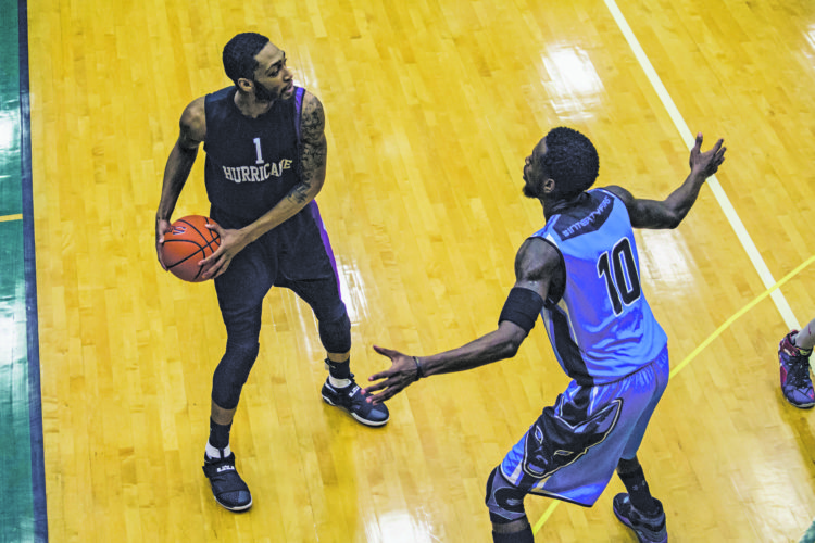 OBSERVER Photo by Brandon Soto Chautauqua Hurricane guard Tyquan Strohman (1) looks to make a pass around Jamestown Jackals' Nathanial Hill (10) during Premier Basketball League action at Jamestown Community College on Sunday.