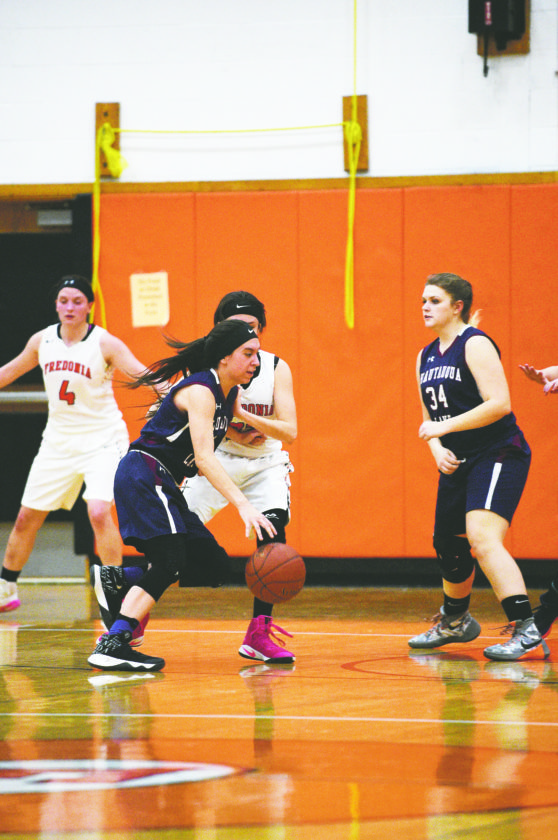 OBSERVERPhotos by Roger Coda At left, Chautauqua Lake's Katelyn Fardink drives to the basket during Tuesday's CCAAWest 1 girls high school basketball game.At left, Fredonia'sGracie Morrison(34) goes up for a layup ahead of Chautauqua Lake's Abigail Henry (10).