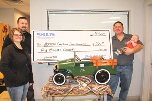 Submitted Photo Recently, Mike Dougherty of Shults Resale donated $500 for the sponsorship of the Vintage Pedal Car, to be auctioned off at Ducks Unlimited's March 11, banquet and live auction. Ducks Unlimited is North America's leader of Waterfowl Habitat and Wetland Conservation. This year marks DU's 80th anniversary. The Northern Chautauqua Chapter event will take place at the Fredonia Beaver Club, with Catering by Devon Jones of Fred's Restaurant. Pictured are, from left, Dougherty, Shults Resale; Stacey Kucharski, DU committee; Ronald Romance, DU committee; and Mason Paul Nichols,  pedal car driver. Missing from the photo were Northern Chautauqua Ducks Unlimited Chapter Committee members Will Mead and Chris McKelvey.  For more information, go to ducks.org and view local events or call Ron at 969-5166.