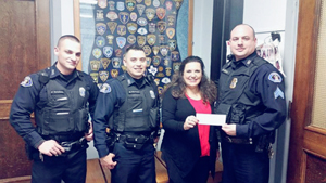 Submitted Photo The Dunkirk Police Benevolent Association recently made a donation to the Blue Star Mothers. Since its inception during World War II, the Blue Star Mothers organization has existed to provide support for active duty service personnel, promote patriotism and assist veterans organizations. Pictured from left are: Officer Jeffrey Ortolano, Officer Matthew Martinez, Blue Star Mothers NY Chapter 4 President Susan Rowley and Sgt. Mark Gruber.