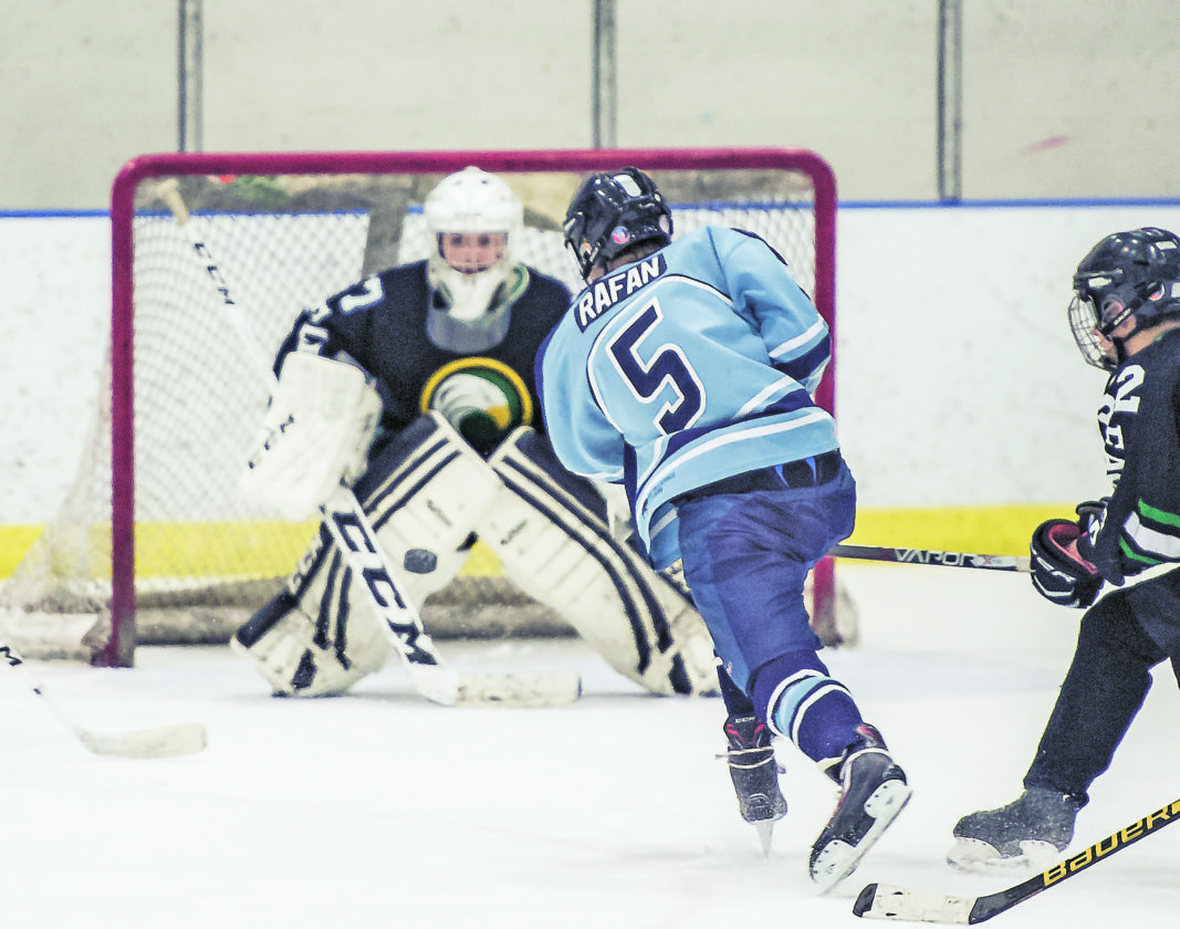 OBSERVERPhoto by Ron Szot Dunkirk-Fredonia's Dawson Rafan lets go the shot that resulted in the eventual game-winning goal against Olean, during their WNYHSCHLplayoff game at the Steele Hall Ice Arena, on Sunday.