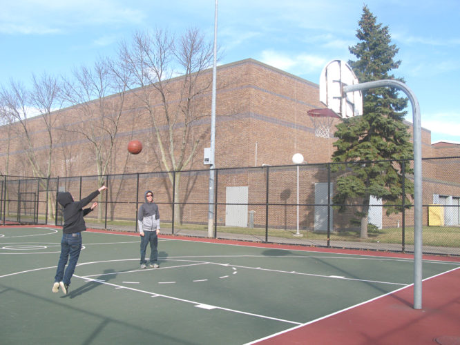 OBSERVER Photo by Amanda Dedie. Ben (left) and Chris Morrow of Fredonia took advantage of the rare, sunshine-y February day Monday by shooting hoops on the SUNY Fredonia basketball court.