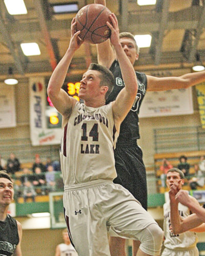 Photo by Mark L. Anderson Chautauqua Lake's Tyler Meredith (14) goes up for a basket in front of an Allegany-Limestone defender during Monday's Section VI Class C1 boys high school basketball semifinal game at Jamestown Community College.