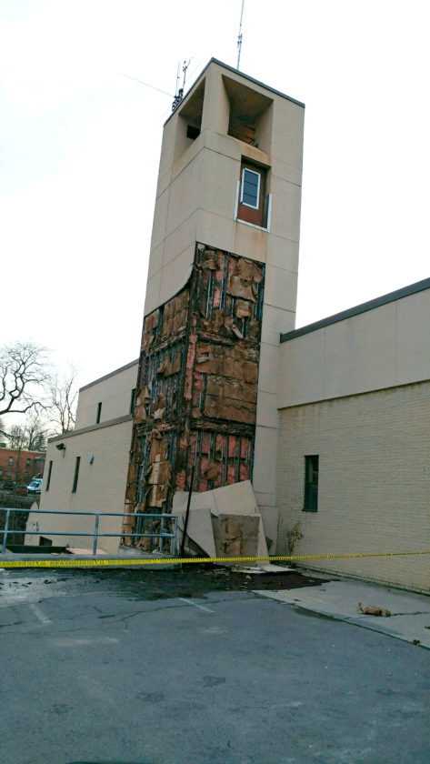 OBSERVER Photo The Fredonia Fire Hall suffered a bit of damage when part of the exterior tiling in the back of the hose tower fell off late last week.