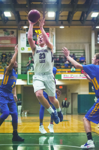 Photo by Valory S. Isaacson Chautauqua Lake's Devin Pope (23) goes up fo a shot against Cleveland Hill, during the Section VI Class C-1 boys basketball championship game, on Friday at Jamestown Community College.