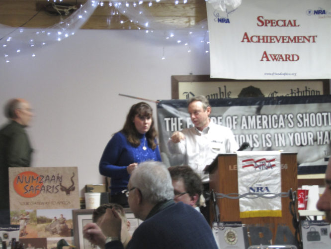 OBSERVER Photo by Gene Pauszek Friends of the National Rifle Association, including Chairman Jennifer Schmitt, left, and Senior Field Representative Jay Rosnock, right, held another successful event at the Samuel  Derby American Legion Post, in Frewsburg, last Saturday.