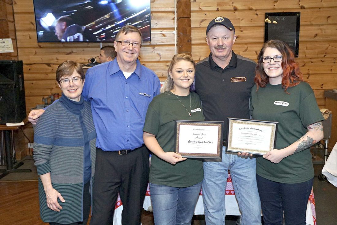 Submitted Photo Betsy T. Wright, president, UPMC Chautauqua WCA; and Jim Yezzi, station manager, Media One Group, congratulate Jim Mee, owner of Gametime Sports Bar and Grill, and two of his chefs for winning the Best Soup Award for SOUPer Bowl Sunday VI 2017.