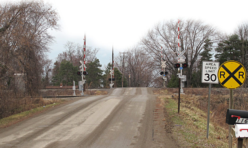 """OBSERVER Photo by Rebecca Cuthbert. Pictured is the railroad crossing at the Hanford Bay entrance point in the town of Hanover, which some residents would like to see converted to a """"Quiet Zone,"""" along with the crossing in Sunset Bay."""