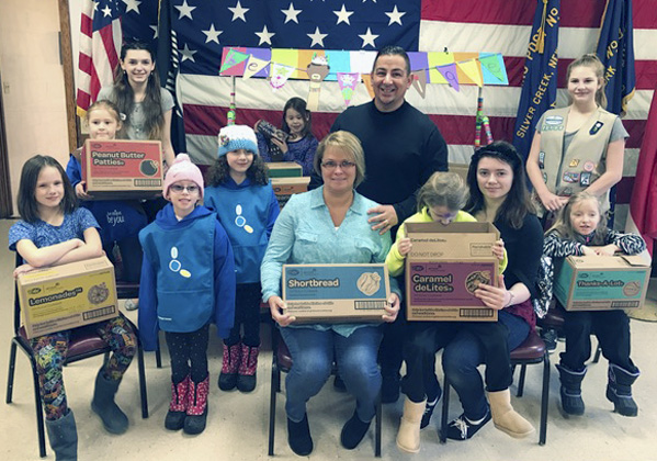 Submitted Photo: Girl Scout Troop 20098 of Silver Creek recently delivered over 60 boxes of cookies to Meals on Wheels clients throughout the greater Silver Creek area in celebration of Dunkirk-Fredonia Meals on Wheels' annual March for Meals. Pictured from left are: Molly Shaw, Kyla Ziegler, Crystal Tirone, Aubrey Waite, Alanna Waite, Gwendolyn Souter, Kathy and Rich White, Lilly Shaw, Aurora Tirone, Trinity Kemp and Kaylee Ziegler.