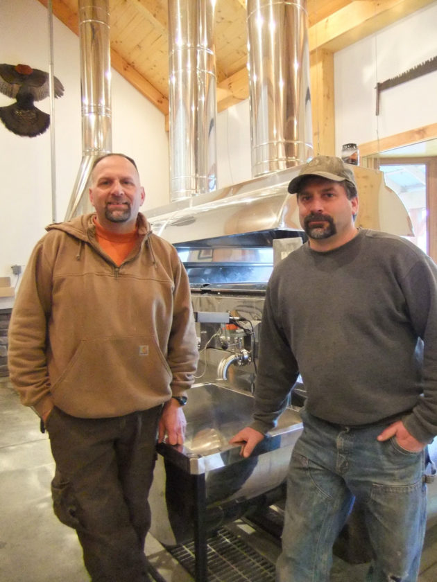 Submitted Photo. Maple Weekend will be held for two consecutive weekends, March 18-19 and 25-26, when New York State Maple Producers will host open houses at their facilities from 10 a.m. to 4 p.m. each day. The Lesefske family invites visitors to their Maple Glen Sugar House in Gowanda, where they can learn firsthand about maple syrup production. From left, brothers Paul and Dana Lesefske are shown in front of the evaporator at their state-of-the-art sugar house, located at 2266 Zoar Road.