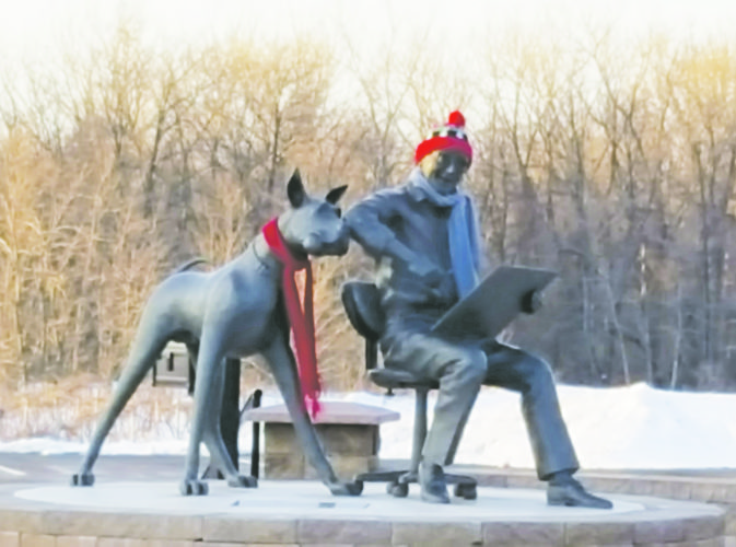 OBSERVER Photo by Nicole Gugino The recent cold snap has more than area residents bundling up. The statue of Brad Anderson and Marmaduke in Brocton was seen donning a hat and scarf recently.