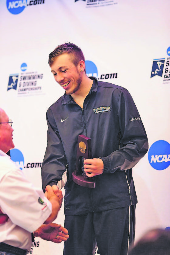 Photo Courtesy of D3Photography.com Fredonia diver Arron Carlson, right, receives his award for earning All-American status during the NCAADivision III 1-meter diving event in Shenandoha,Texas, on Thursday. Carlson competed in the 3-meter event on Saturday and finished third.