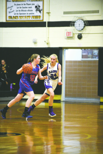 OBSERVER File Photo Pine Valley's Zoe Nelson (24) guards Cassadaga Valley's Kelly Butcher during a non-league girls basketball game earlier this season. Nelson was named to the CCAA East 2 First Team recently by coaches in the divisions.